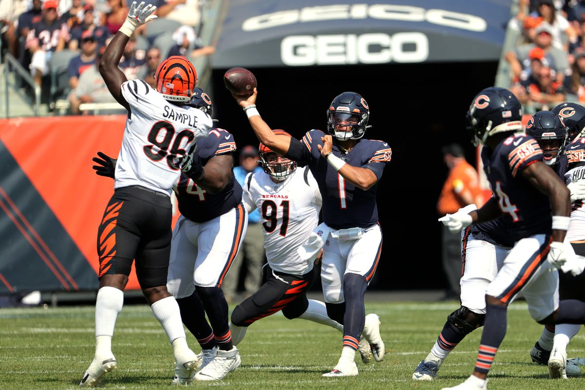 Quarterback Justin Fields #1 of the Chicago Bears throws the ball over defensive end Cameron Sample #96 of the Cincinnati Bengals during the second half at Soldier Field on September 19, 2021 in Chicago, Illinois.