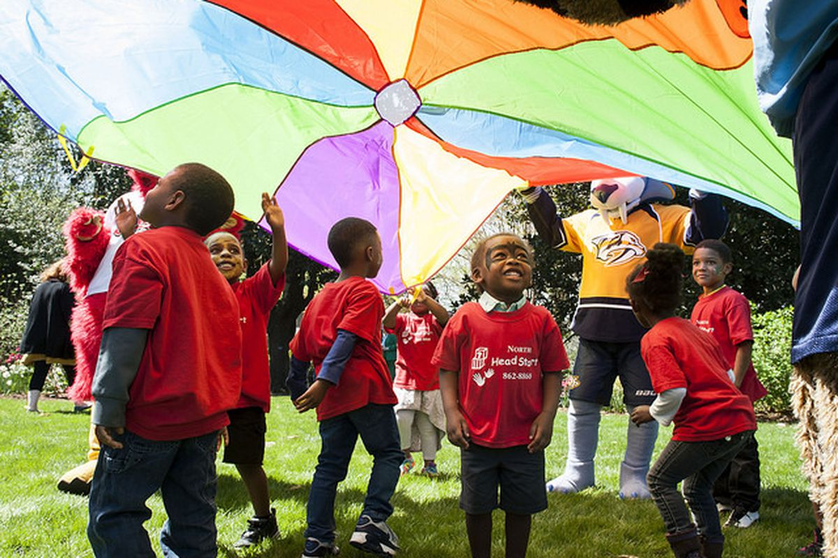Children in Head Start programs in Nashville enjoy games on the lawn of the governor's mansion in 2017. Tennessee is putting more emphasis on pre-K as a key to reaching statewide reading goals.