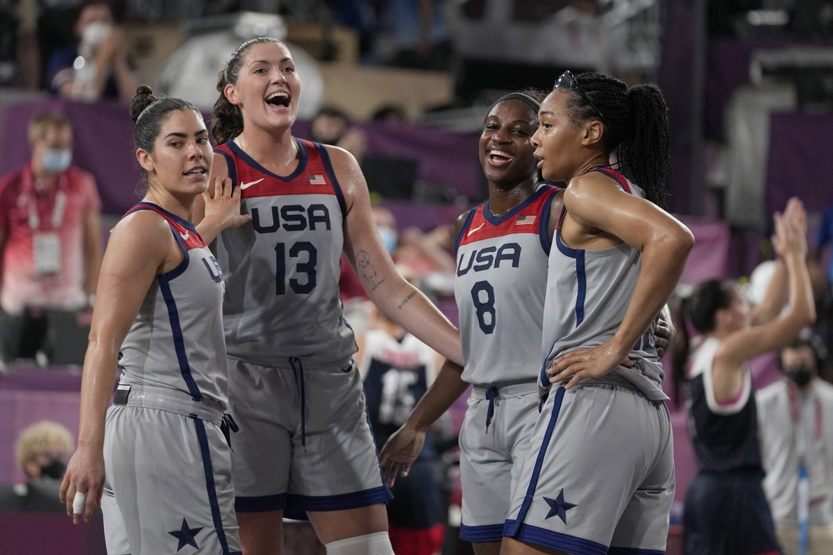 The United States' Kelsey Plum, left, Stefanie Dolson (13), Jacquelyn Young (8) and Allisha Gray celebrate after defeating Russian Olympic Committee in the women's 3-on-3 gold medal basketball game.