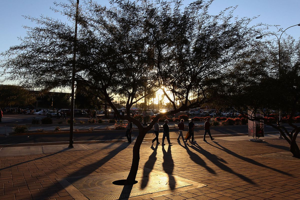 TEMPE, AZ - DECEMBER 30:  Fans arrive to Sun Devil Stadium before the Insight Bowl between the Oklahoma Sooners and the Iowa Hawkeyes on December 30, 2011 in Tempe, Arizona.  (Photo by Christian Petersen/Getty Images)
