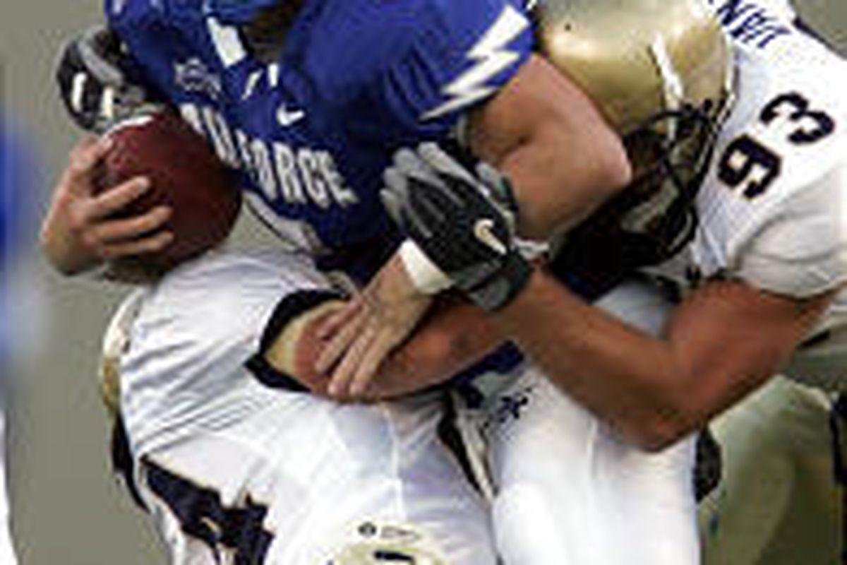 Air Force quarterback Shaun Carney (5), so impressive last Saturday in a loss at Utah, is tackled by Navy linebacker Lane Jackson (44) and defensive end Jeff Vanak (93) at Colorado Springs.