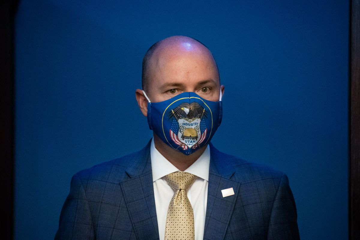 Utah Gov. Spencer Cox wears a mask with the Utah state flag during a COVID-19 briefing in April 2021.