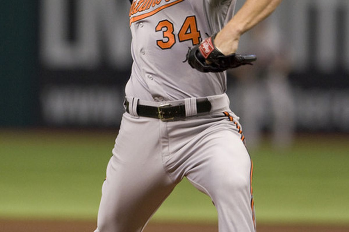 June 3, 2012; Tampa, FL, USA; Baltimore Orioles starting pitcher Jake Arrieta (34) delivers a pitch in the first inning of a game against the Tampa Bay Rays at Tropicana Field.  Mandatory Credit: Jeff Griffith-US PRESSWIRE