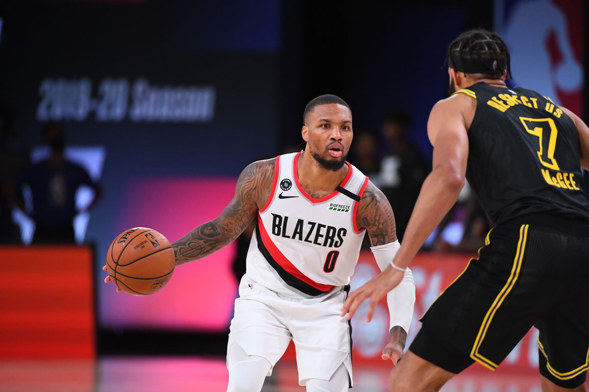 Damian Lillard #0 of the Portland Trail Blazers handles the ball during the game against the Los Angeles Lakers during Round One Game Four of the NBA Playoffs on August 24, 2020 at The AdventHealth Arena at ESPN Wide World Of Sports Complex in Orlando, Florida.