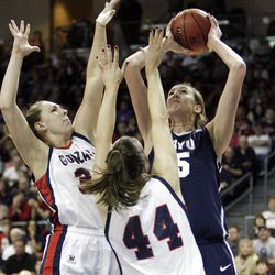 Brigham Young Cougars center Jennifer Hamson (5) shoots over Gonzaga Bulldogs forward Kelly Bowen (44)  in the West Coast Conference finals in Las Vegas  Monday, March 5, 2012.  BYU won the title and will advance to the NCAA tournament.