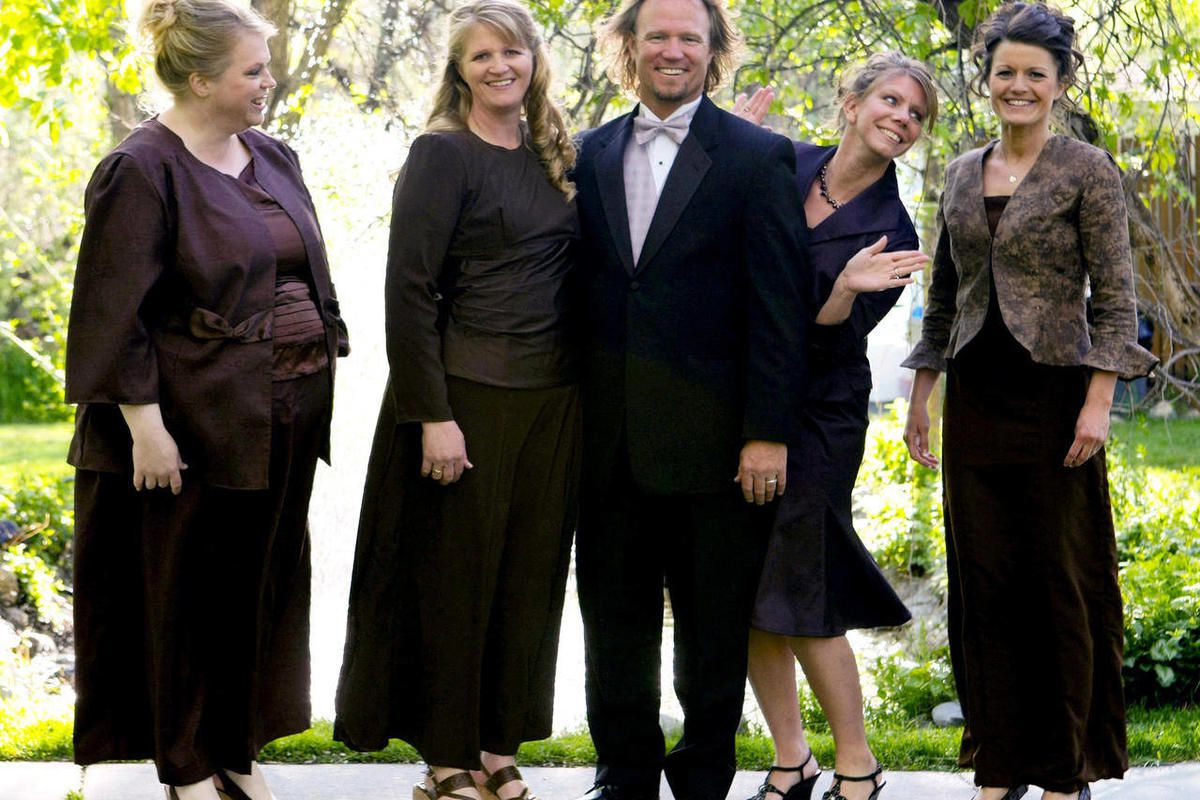 """FILE - In this undated file photo provided by TLC, Kody Brown, center, poses with his wives, from left, Janelle, Christine, Meri, and Robyn in a promotional photo for TLC's reality TV show, """"Sister Wives.""""   A lawmaker who says Utah should avoid legislati"""