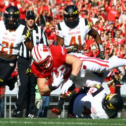 Troy Fumagalli leaps over a defender on a 4th down conversion.