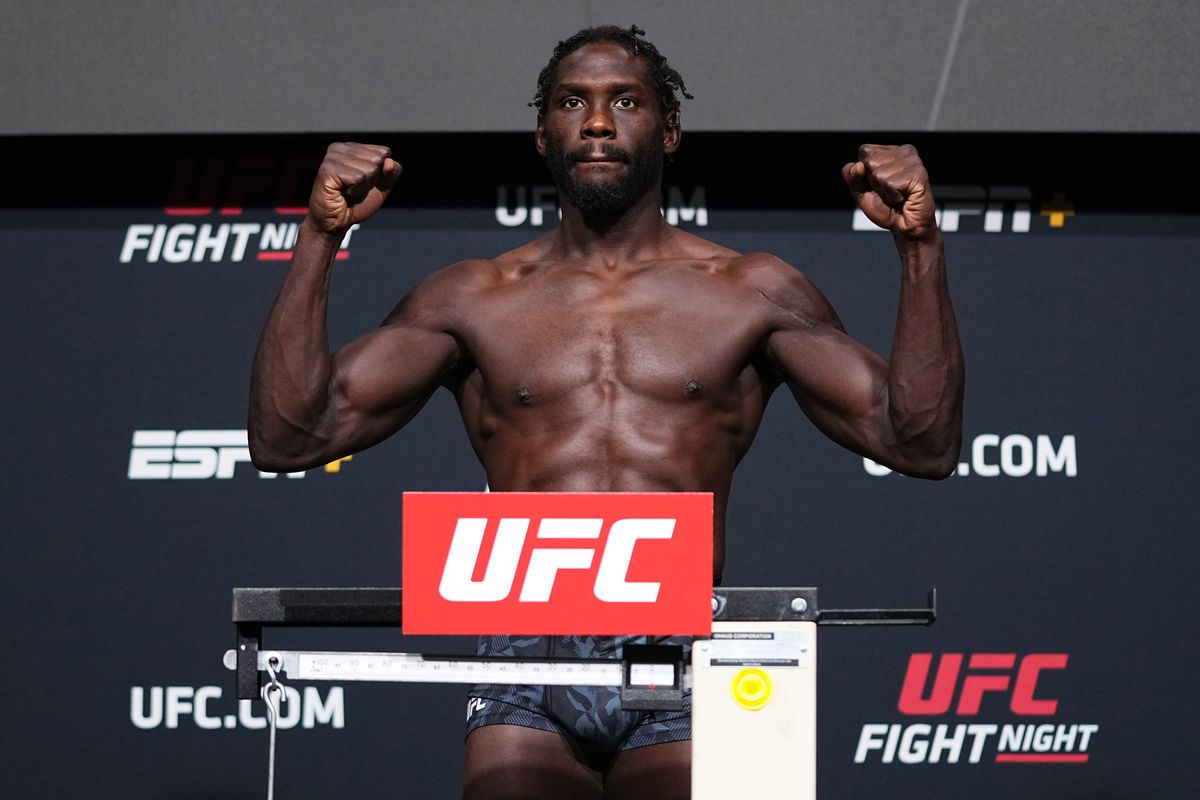 In this UFC handout, Jared Cannonier poses on the scale during the UFC Fight Night weigh-in at UFC APEX on August 20, 2021 in Las Vegas, Nevada.