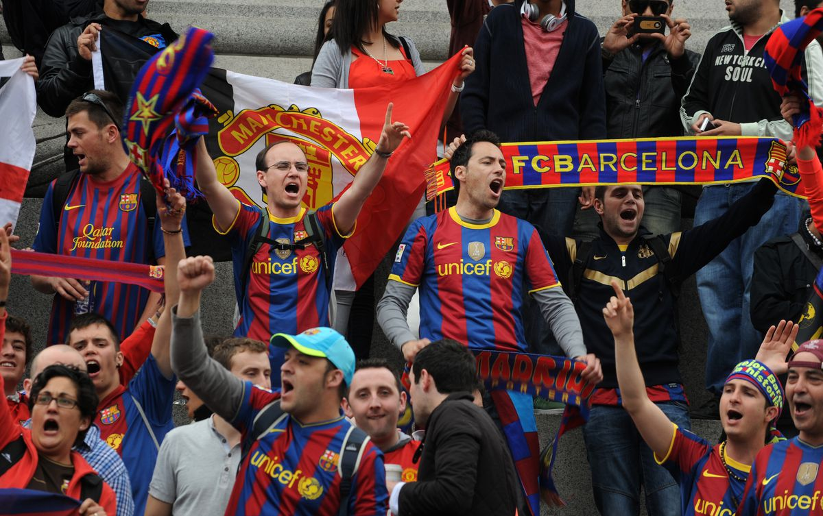 Barcelona football fans sing in front of