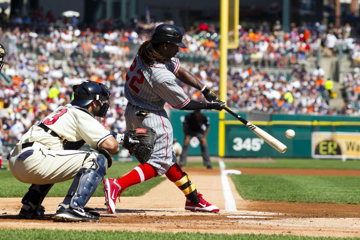 May 19, 2012; Detroit, MI, USA; Pittsburgh Pirates center fielder Andrew McCutchen (22) hits a two run home run during the first inning against the Detroit Tigers at Comerica Park. Mandatory Credit: Rick Osentoski-US PRESSWIRE