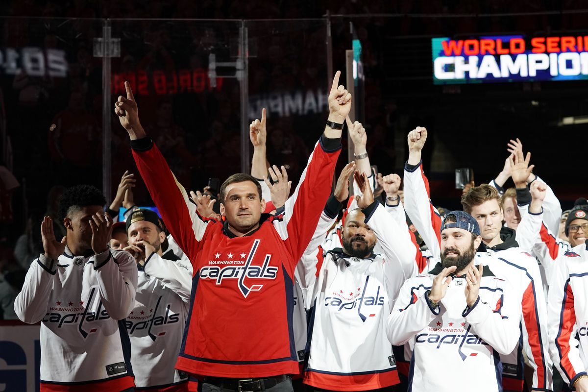 Ryan Zimmerman (red jersey) and the Nationals get recognized for their World Series victory at the Capitals game Sunday in D.C.