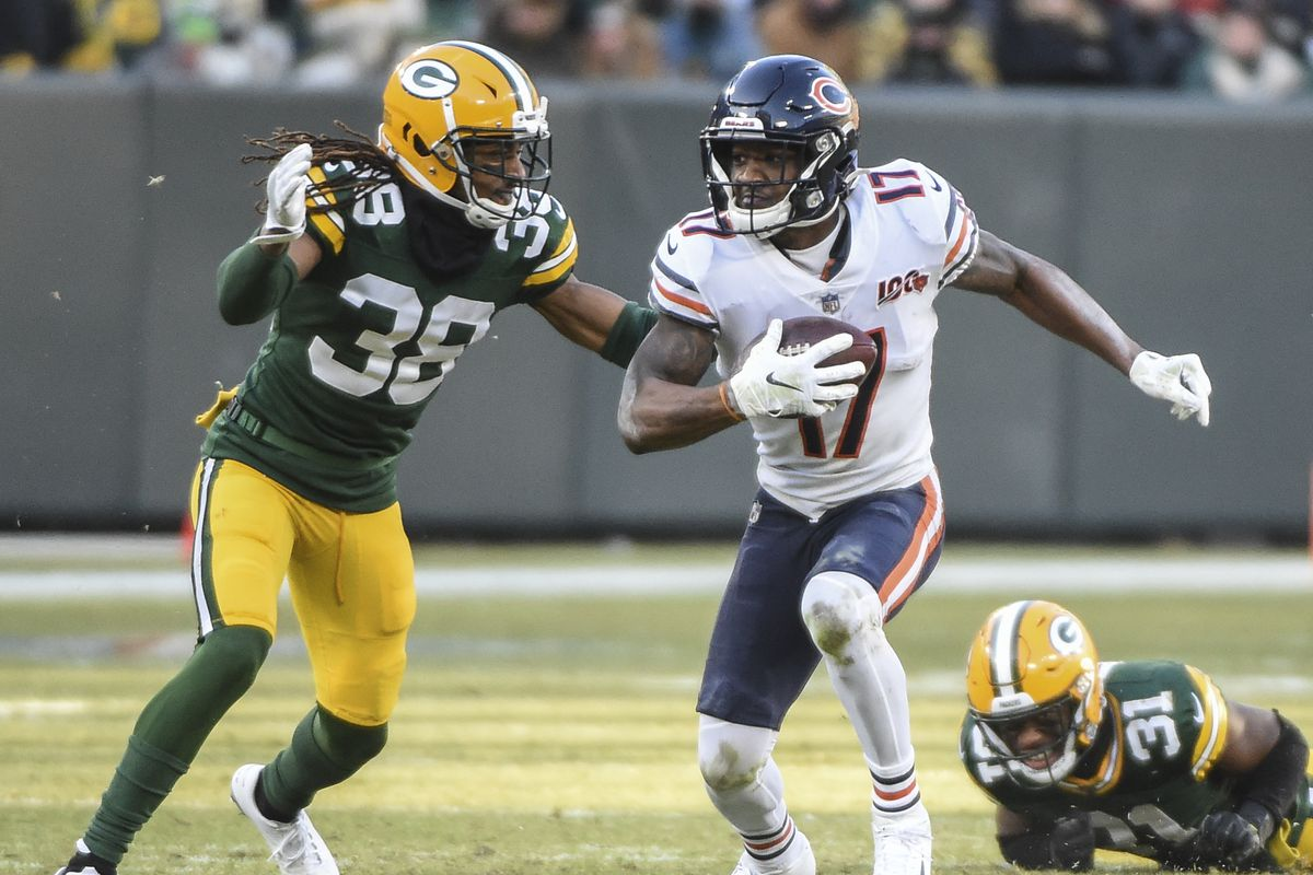 Chicago Bears wide receiver Anthony Miller tries to avoid a tackle by Green Bay Packers cornerback Tramon Williams in the fourth quarter at Lambeau Field