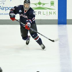 UConn's Miles Gendron (10) passes the puck on the power play.