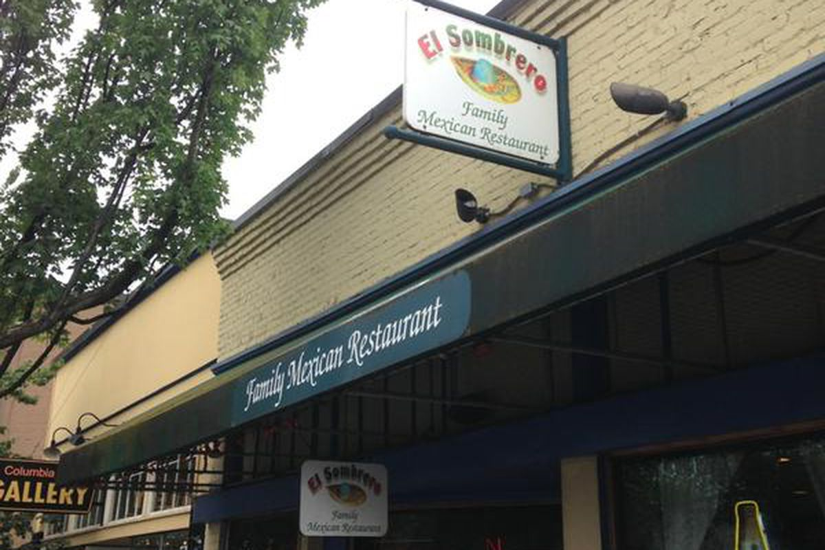 The exterior of El Sombrero with the restaurant's sign out front.