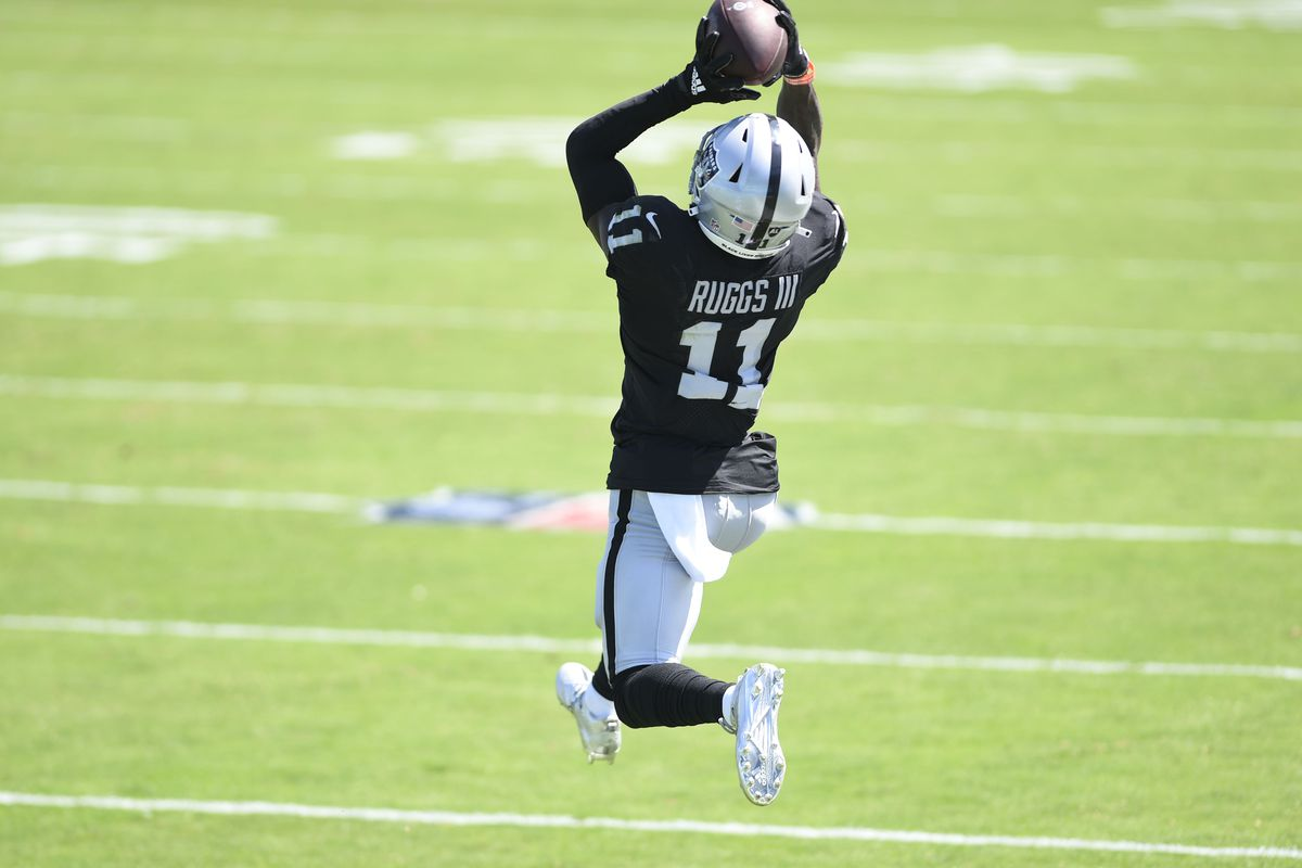 Las Vegas Raiders wide receiver Henry Ruggs III (11) tries to make a catch in the second quarter at Bank of America Stadium.