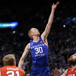 Brigham Young Cougars guard TJ Haws (30) lays it up during the game against the Utah Utes at the Marriott Center in Provo on Saturday, Dec. 16, 2017.
