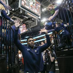 Utah Jazz guard Donovan Mitchell (45) leaves the court after the Jazz won 119-79 over the Golden State Warriors at Vivint Arena in Salt Lake City on Tuesday, April 10, 2018.