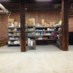 The only remaining racks in what used to be a packed storage area for dry products.