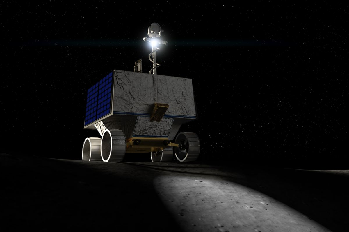 A rover with a light is pictured exploring the lunar surface in the dark.