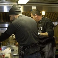 Joseph Leibowitz and his sous chef Sonny Beck cooking on the Roamin Dough food truck.