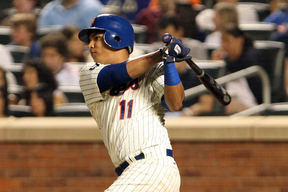 July 3, 2012; Flushing, NY,USA;   New York Mets shortstop Ruben Tejada (11) singles to left during the sixth inning against the Philadelphia Phillies at Citi Field.  Mandatory Credit: Anthony Gruppuso-US PRESSWIRE