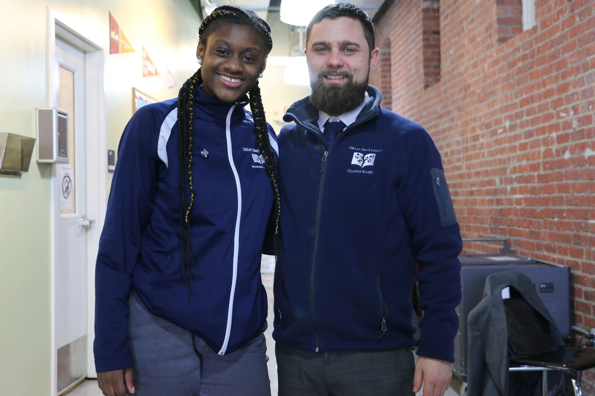 Great Oaks Legacy Charter School Principal Jared Taillefer with 10th-grader Tanesha Golding.