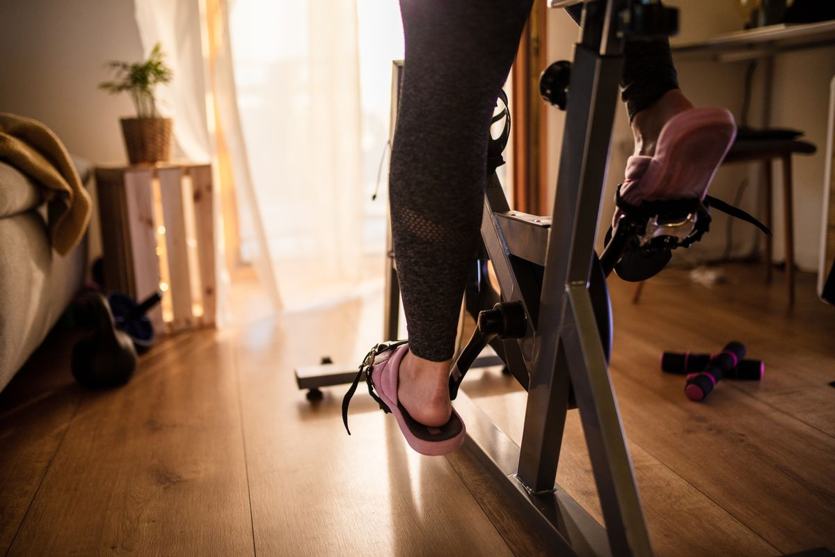 A woman's feet on an at-home workout bike.