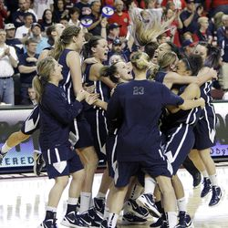Brigham Young Cougars celebrate as they win in the West Coast Conference finals in Las Vegas  Monday, March 5, 2012.