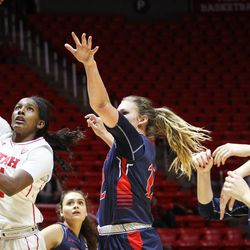 Utah Utes guard Erika Bean (11) takes a hook shot past Saint Mary's guard Katie Rathbun (20) and forward Sydney Raggio (12) as Utah hosts Saint Mary's at the Huntsman Center in Salt Lake on Saturday, Dec. 2, 2017.