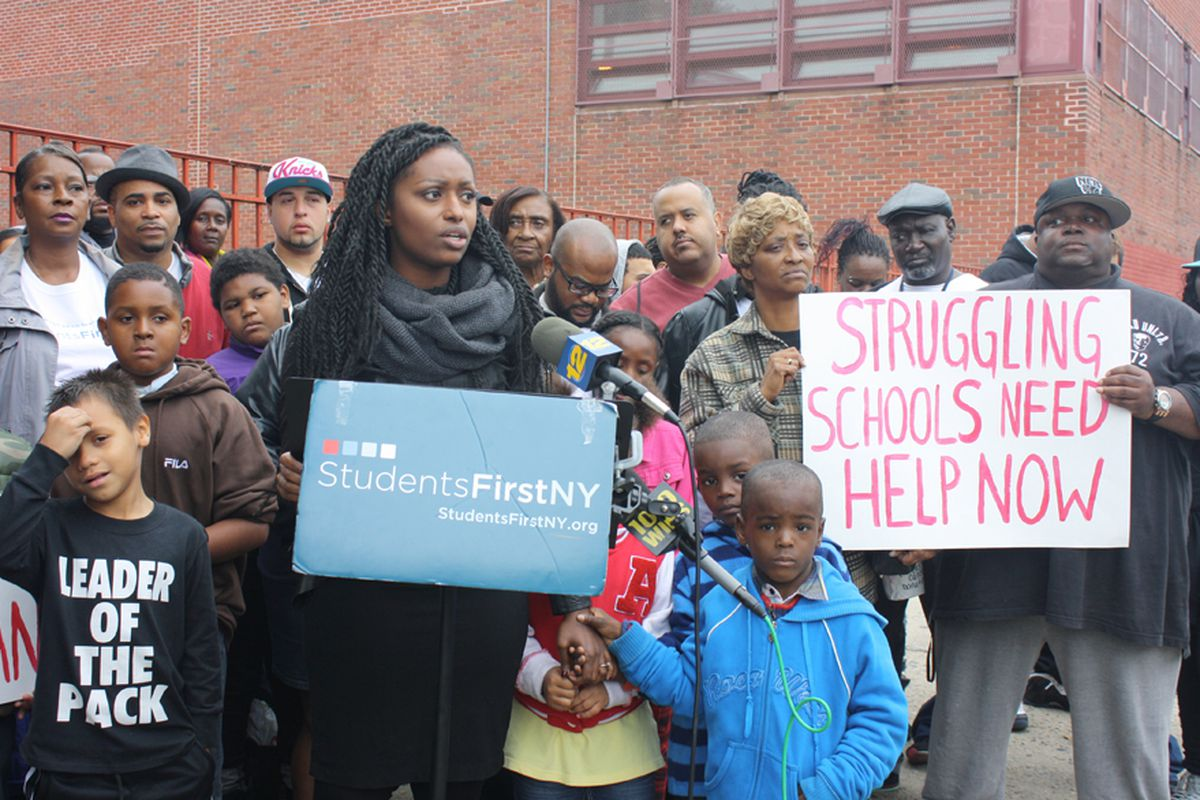 Tenicka Boyd, an organizer for StudentsFirstNY, spoke at a rally outside Boys and Girls High School in Brooklyn.