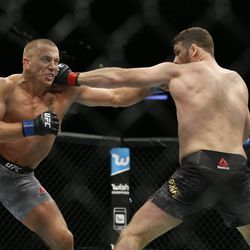 St-Pierre and Bisping trade jabs early on in their championship bout.