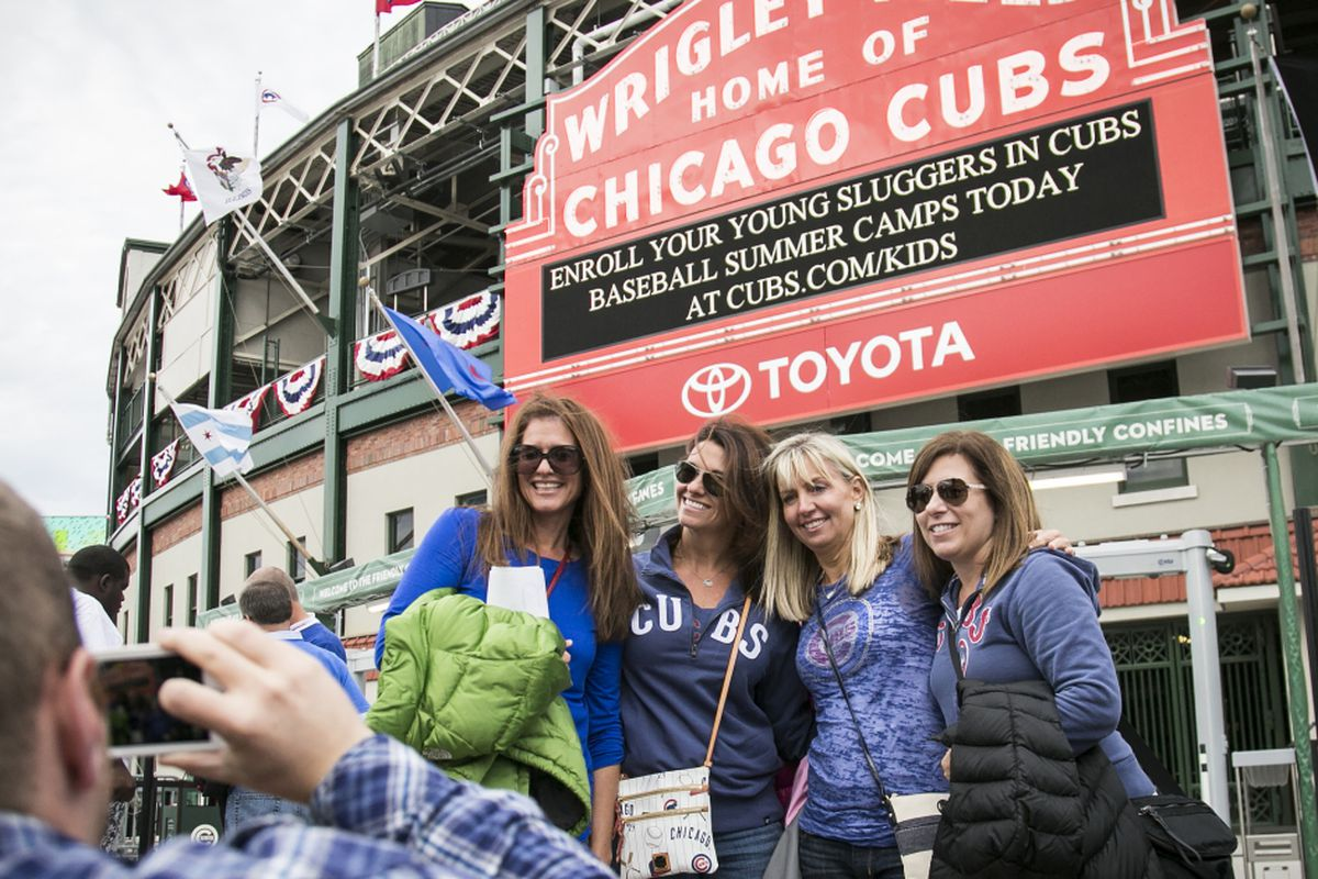 aa01f0b1cde13 Fans take photos in front of Wrigley Field on Friday