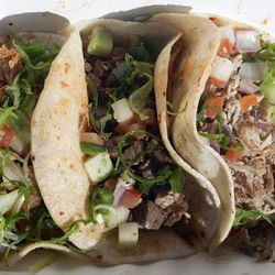 """Tacos from The Kimchi Taco Truck by <a href=""""http://www.flickr.com/photos/pabo76/5489980284/in/pool-eater"""">Pabo76</a>."""