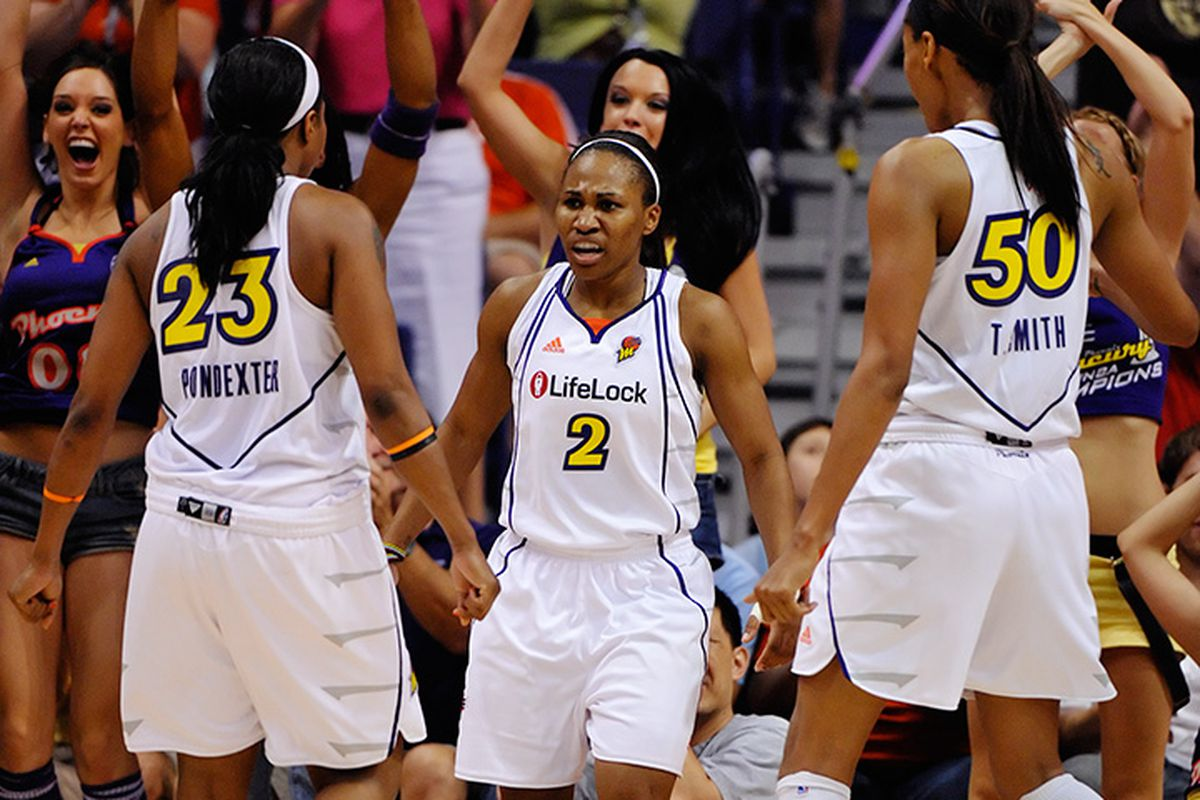 Phoenix Mercury point guard Tameka Johnson shows her intensity after scoring against the LA Sparks. The Mercury defeated the Sparks 89-80 in Phoenix. June 19, 2009. Photo by Max Simbron