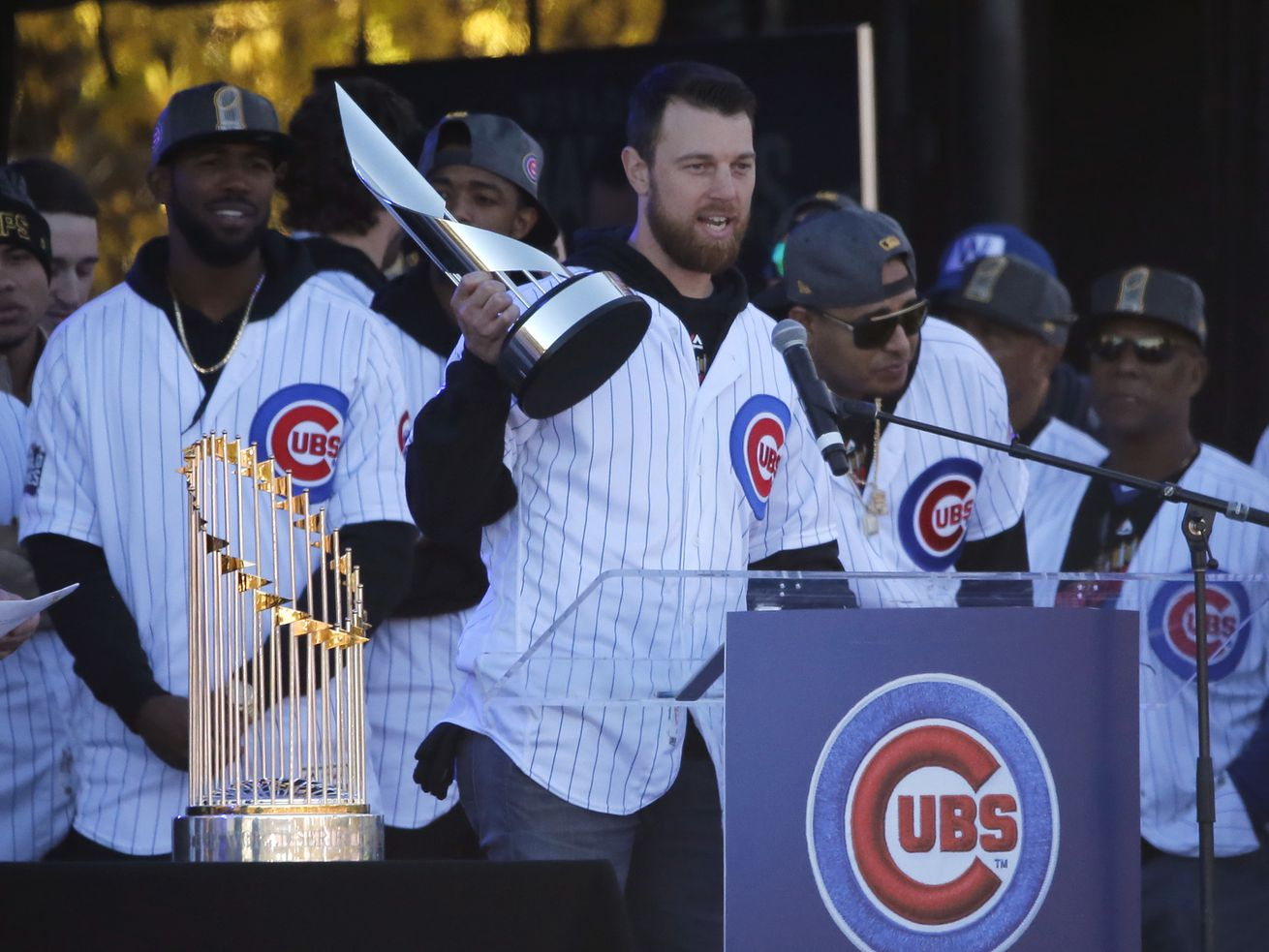 Ben Zobrist holds up the World Series MVP trophy during the Cubs' World Series celebration at Grant Park in 2016.