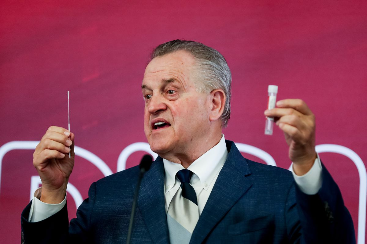 Fred P. Lampropoulos, chairman and CEO of Merit Medical, holds up a COVID-19 test kit developed by his company during a press conference at the company's headquarters in West Jordan on Tuesday, April 21, 2020.