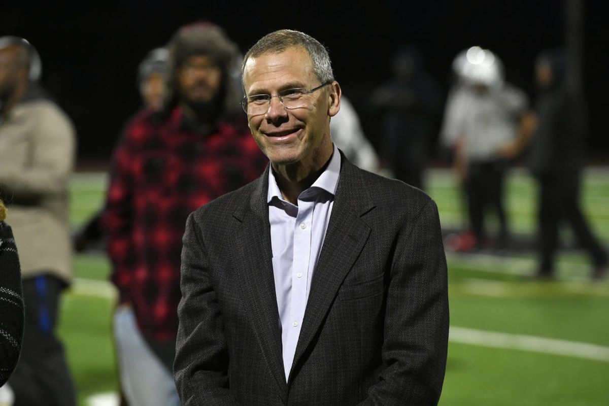 Denver Public Schools Superintendent Tom Boasberg smiles as he checks out the new lights on the football field at the Montbello campus earlier this month.