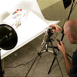 Trent Fordham, founder of AuctionOpolis, photographs an item for one of his customers. The business will then list the item on eBay and ship it to the buyer.
