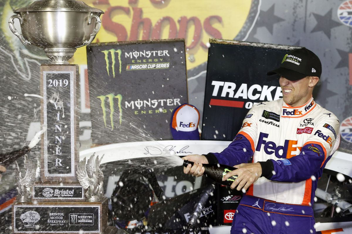Denny Hamlin, driver of the #11 FedEx Freight Toyota, celebrates in Victory Lane after winning the Monster Energy NASCAR Cup Series Bass Pro Shops NRA Night Race at Bristol Motor Speedway on August 17, 2019 in Bristol, Tennessee.