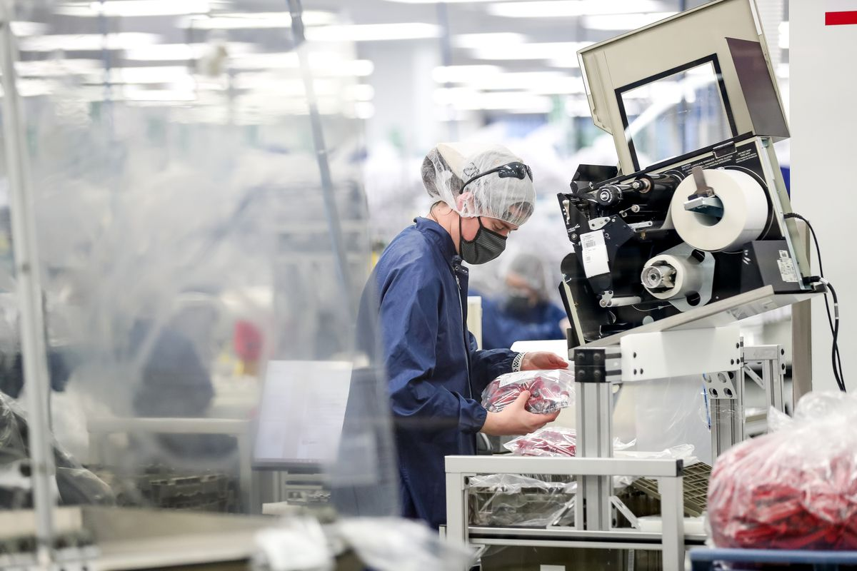 People work in a Merit Medical manufacturing facility in West Jordan on Tuesday, April 21, 2020. The company is now producing COVID-19 test kits at one of its Utah facilities.