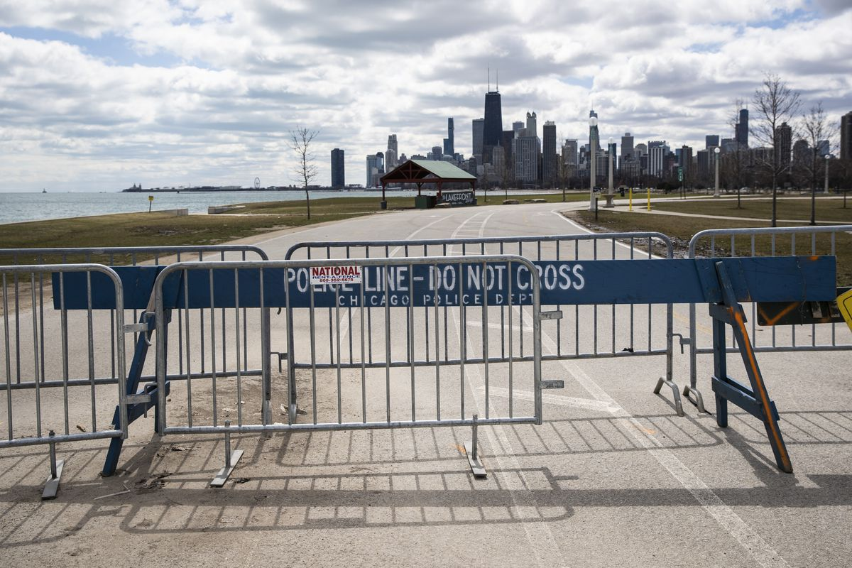 Chicago police barricades block access to the Lakefront Trail at Fullerton Avenue as the area remains closed to pedestrians amid fears of the coronavirus pandemic.