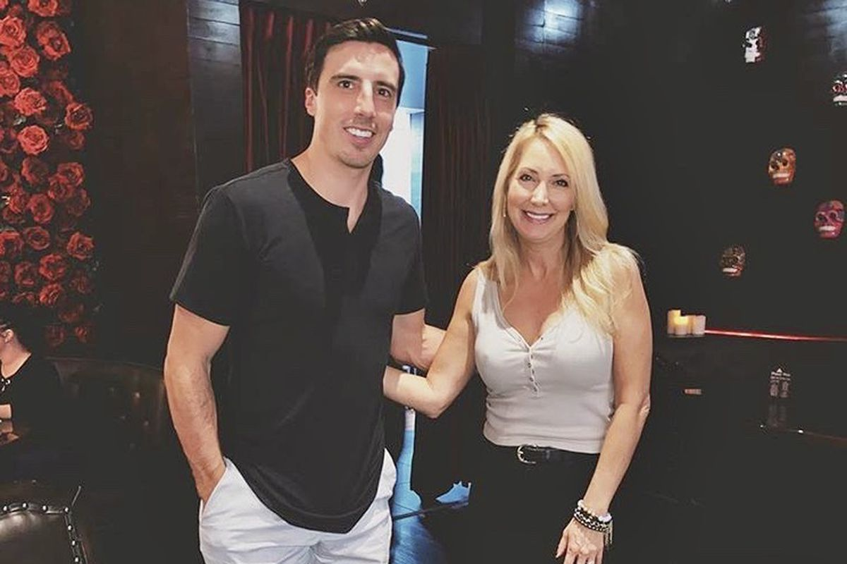 A man in a black shirt and a woman in a white tank top