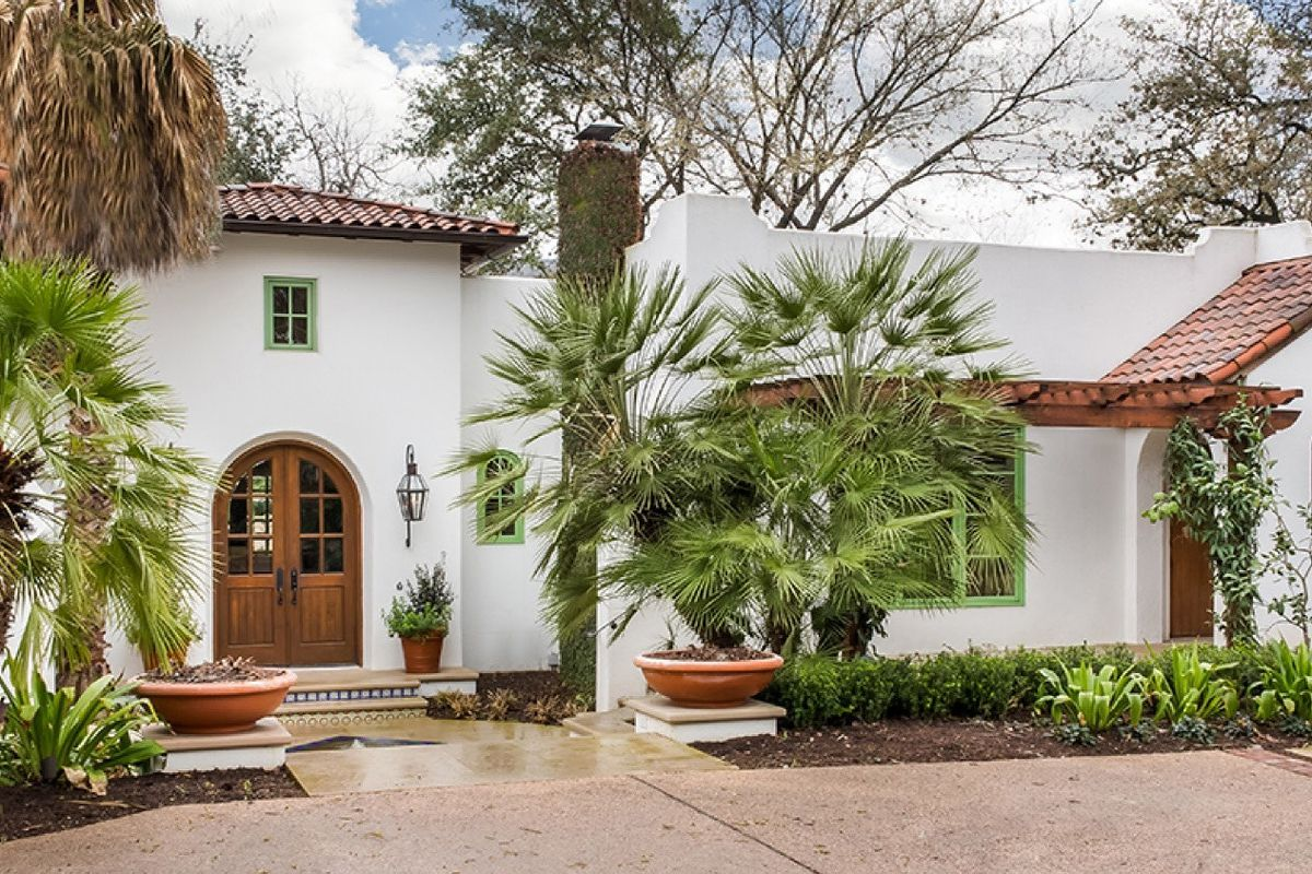 White stucco Spanish Colonial with red tile roof
