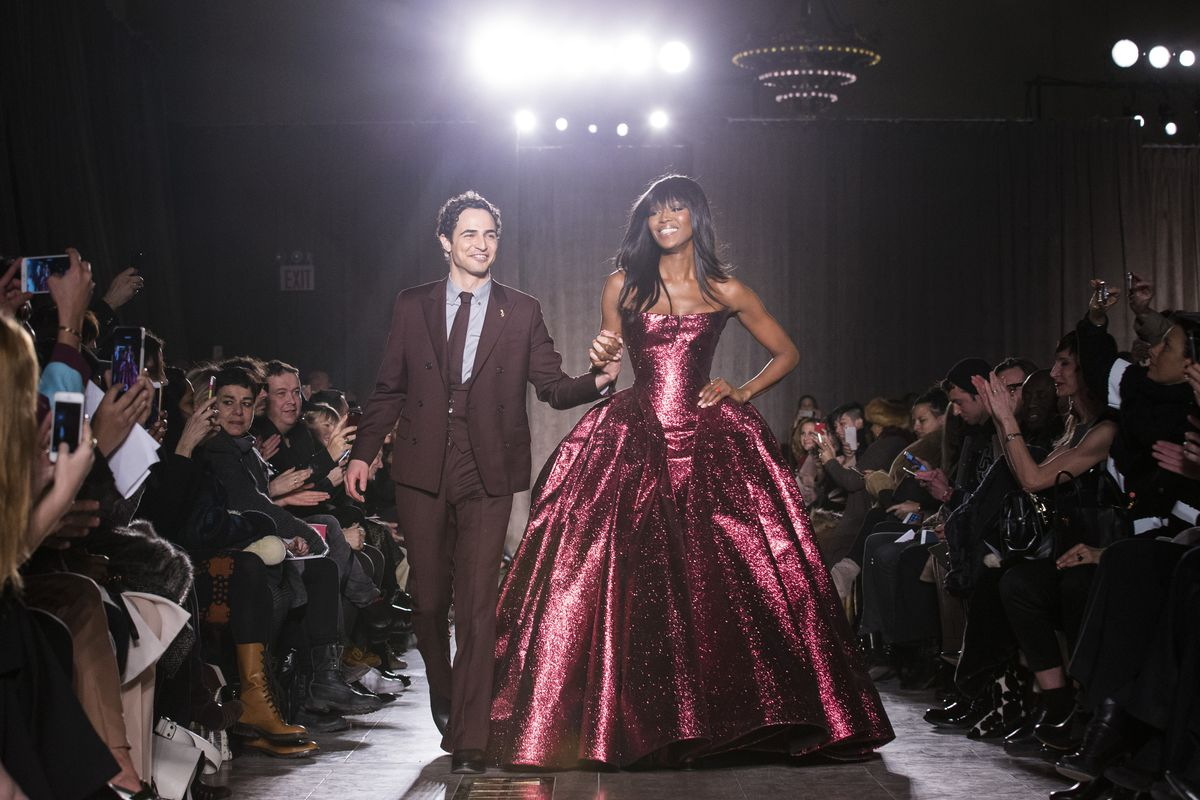 Designer Zac Posen and model Naomi Campbell greet the crowd after his Fall 2015 collection is modeled during Fashion Week in New York.