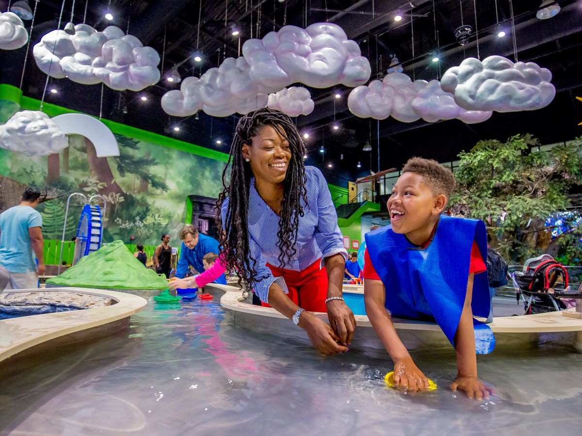 Children play in water in the Please Touch Museum in Philadelphia.
