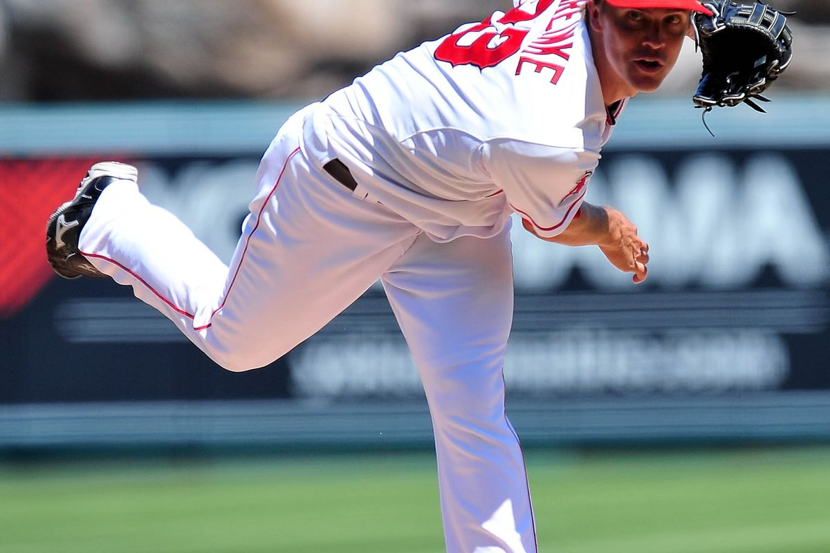 September 9, 2012; Anaheim, CA, USA; Los Angeles Angels starting pitcher Zack Greinke (23) pitches in the third inning against the Detroit Tigers at Angel Stadium. Mandatory Credit: Gary A. Vasquez-US PRESSWIRE