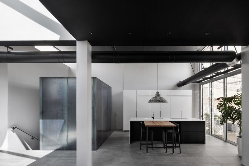 Open plan apartment with industrial interiors,