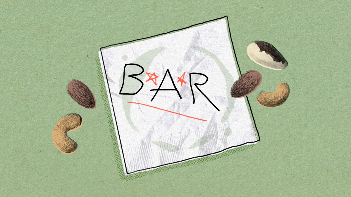 """a bar napkin with """"B * A * R*"""" written on it, surrounded with some loose mixed nuts"""