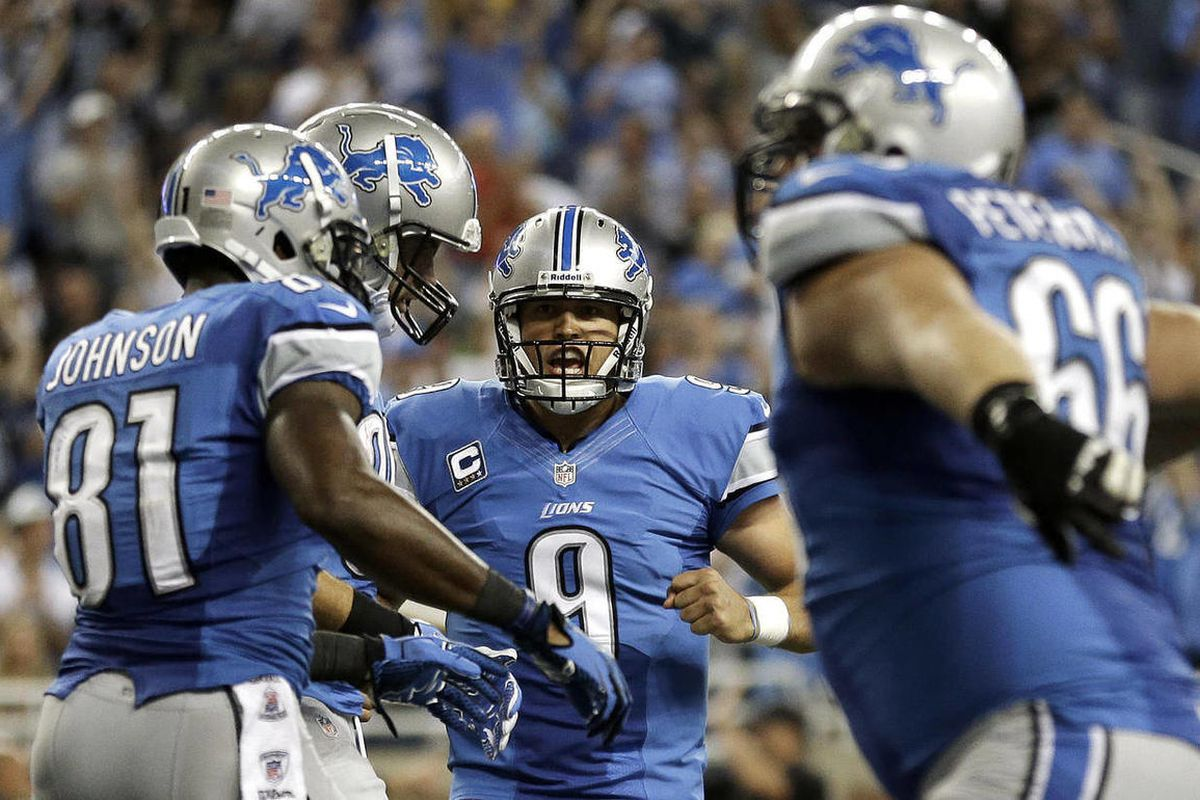 Detroit Lions quarterback Matthew Stafford (9) celebrates his 5-yard touchdow pass to Kevin Smith in the fourth quarter of an NFL football game against the St. Louis Rams in Detroit, Sunday, Sept. 9, 2012. Detroit won 27-23.