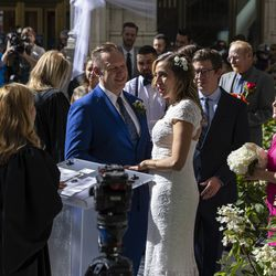 A couple stands at the altar outside the Wrigley Building on N Michigan Ave during the Meet Me on The Mile Sunday Spectacle Sunday, Sept. 26, 2021. 50 couples were married outside the Wrigley Building during The Mile Sunday Spectacle. | Anthony Vazquez/Sun-Times